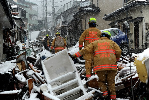 Urban search and rescue teams working with USAID/OFDA help search for survivors after the 2011 earthquake and tsunami in Japan.