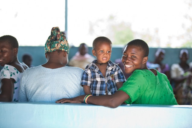 Smiling family at Engender Health supported clinic in Mwanza, Tanzania