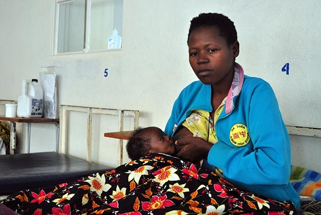 A mother nurses her child in a hospital in Rwanda