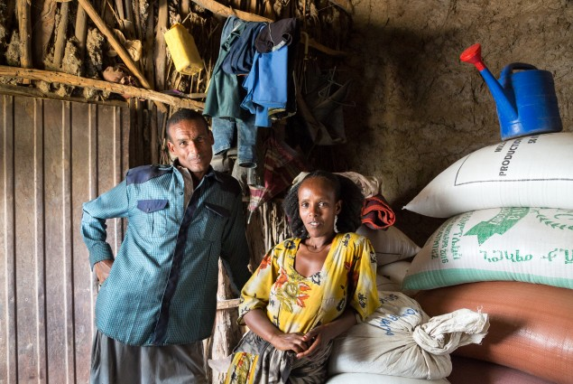As a model farmer and VESA (village economic and social association) chairperson, Etsay Wayu (left) helps his fellow VESA members gain the knowledge, skills, and confidence they need to turn their lives around. Here Etsay and his wife, Mulu Girmay, are pictured in their store room. Thanks to USAID, they have learned new ways to manage their farm and earn and manage their income. As a result of all they learned, the family now has their own safety net: more than a year's worth of food in storage.