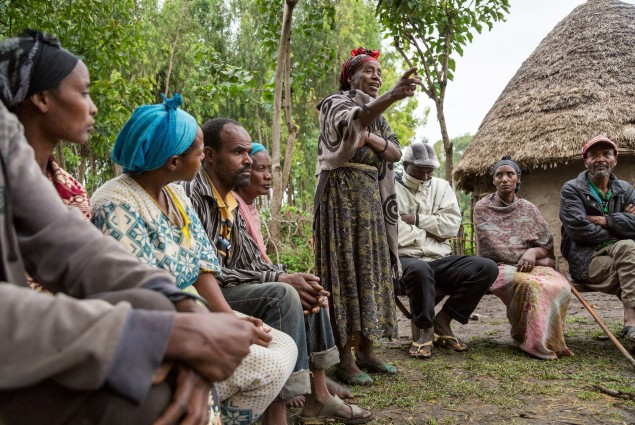 A culture of saving. A member of Nigat Chora (Sunrise) Village Economic and Social Association (VESA) stands up to speak during a meeting. Comprised of groups  of neighbors and peers, VESAs are the foundation of all GRAD-supported activities. VESAs also provide savings and credit facilities to members. When Nigat Chora was established five years ago, its 23 member households were some of the poorest in the community. Today a 'culture of saving' has helped transform members' lives.