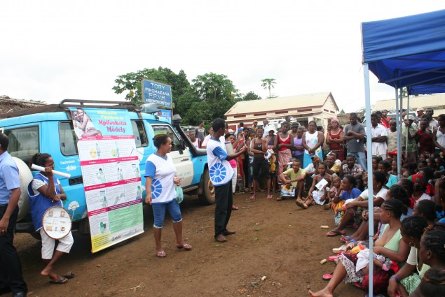 Community health volunteers explain family planning methods to members of the community