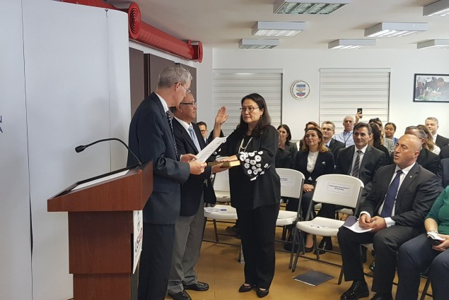 Ambassador Delawie administers the Oath of Office