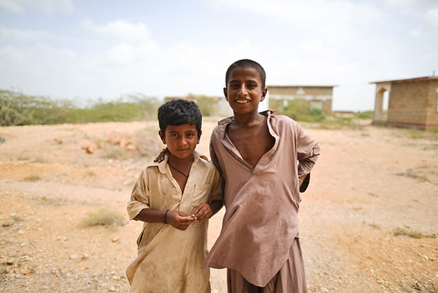 Two boys smile at the camera