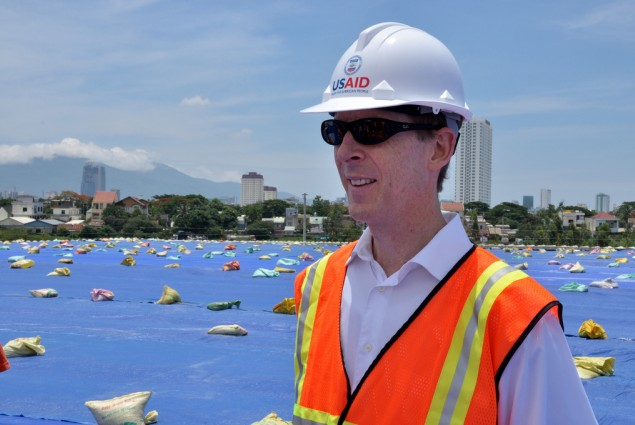 USAID Mission Director Joakim Parker assesses progress at the Environmental Remediation of Dioxin Contamination Project at Danan