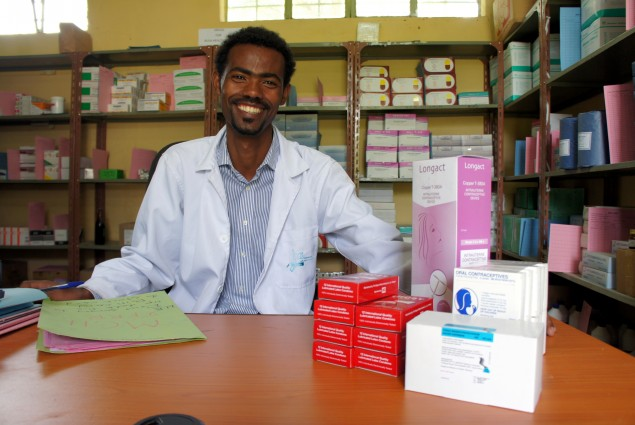 Andualam Tessema, pharmacy head, in the Bussa Health Center Drugstore, South West Shewa Zone, Oromia Region, Ethiopia.  The USAID Deliver project, in partnership with the Ministry of Health and other organizations, improves health outcomes by increasing the availability of health supplies. For more than 30 years, USAID has been a world leader in providing health commodities.