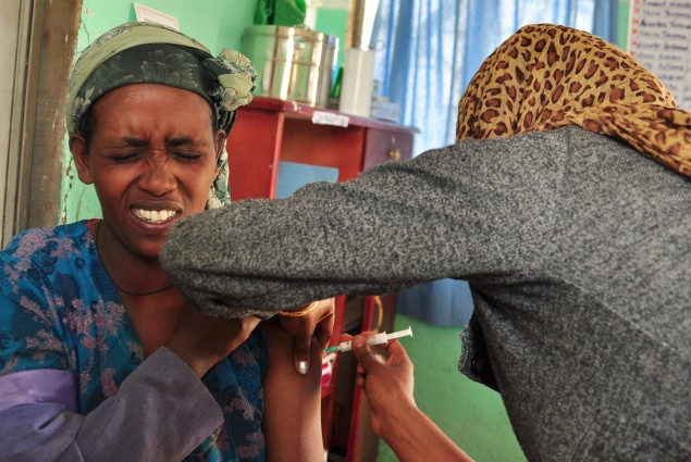 Natsaannat, a health extension worker in Ethiopia, gives an injectable contraceptive to Itenish in Wara Village.