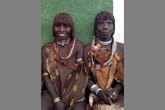 Dobe Oyita and Sayu Elu are members of the Hamar tribe. As females, it's their job to walk for miles to get water for their fami