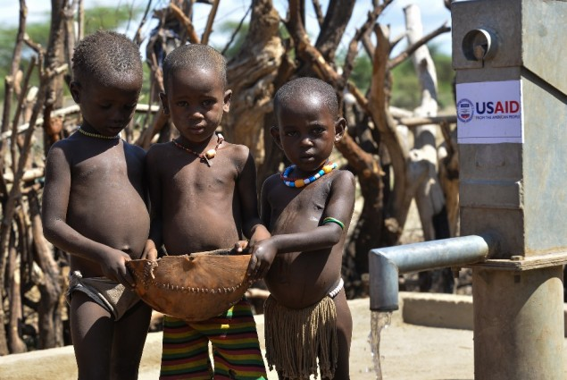 Image of children in Ethiopia at a water pump built by USAID