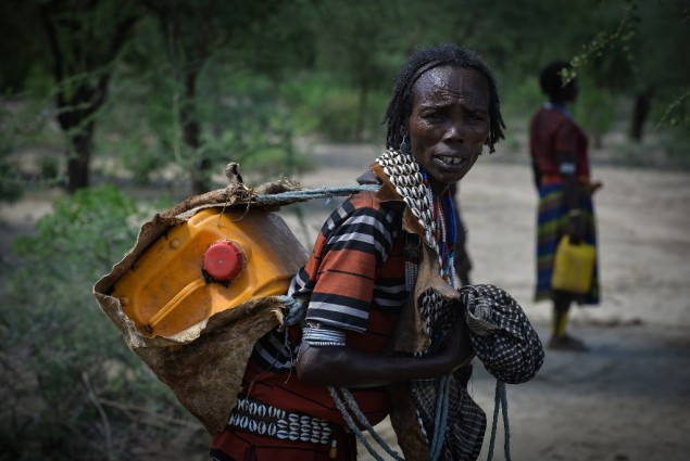 Image of woman carrying water container in Ethiopia