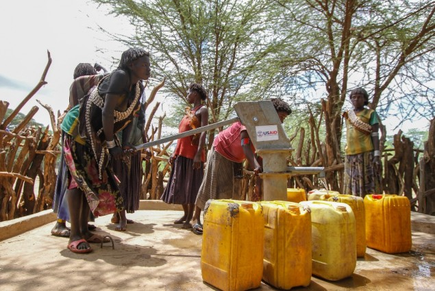Image of woman pumping water from a well in Ethiopia