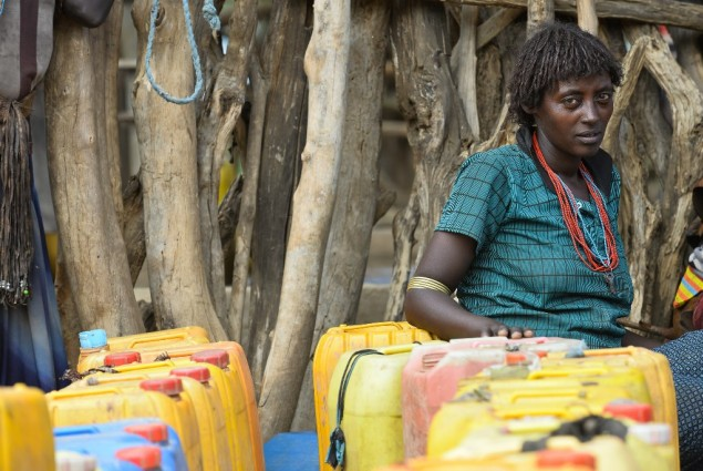 Image of woman waiting to fill her water containers in Ethiopia
