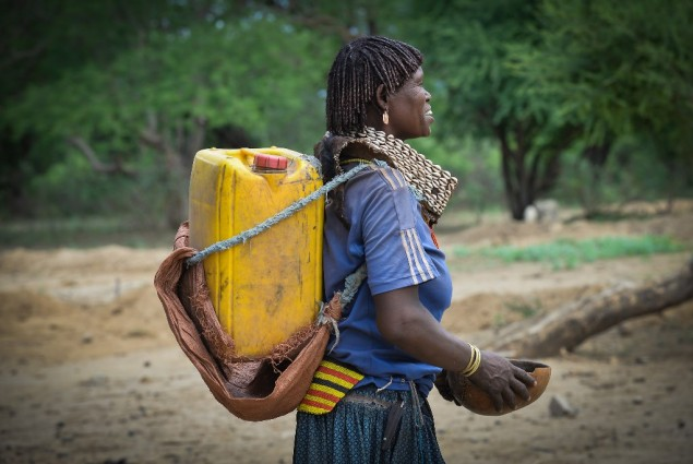 Image of woman in Ethiopia carrying water jug