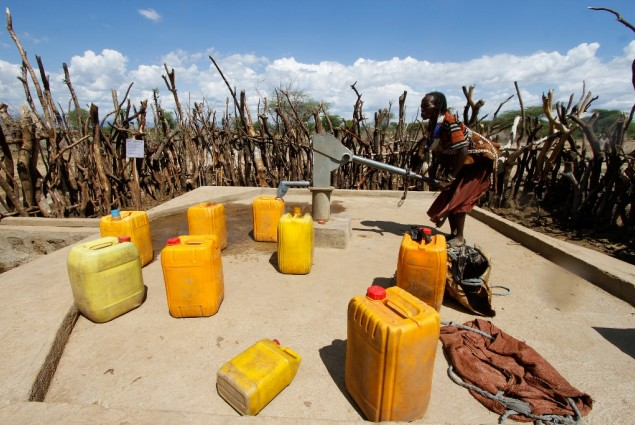 Image of woman pumping water in Ethiopia