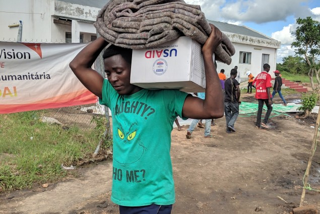 DAI victm taking home his belongings after receiving from USAID
