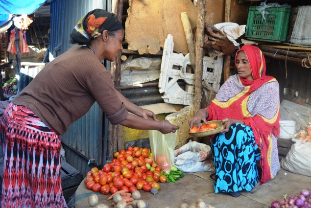 Adebo Berta, a widow and mother of four children, sells vegetables at a local market just few meters from her house.