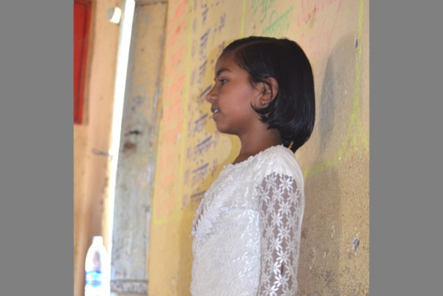In the Beed district of Maharashtra, a student presents her own story based on the words written on the board. Children have the