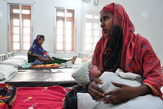 A mother holds her newborn at the Special Care Newborn Unit in Jaintapur Upazila in northern Bangladesh