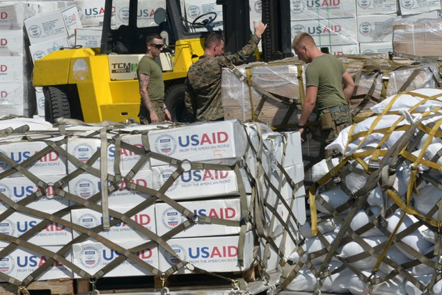 US marines prepare relief goods before they are loaded onto a US KC-130 plane for victims of Super Typhoon Haiyan in Tacloban, a