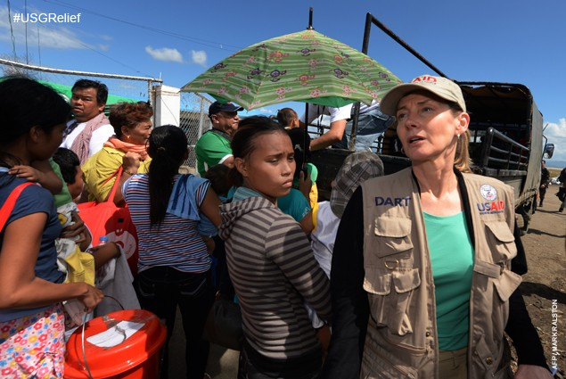 Assistant Administrator of USAID Nancy Lindborg (R) arrives at Tacloban Airport on November 18, 2013 to inspect relief efforts i