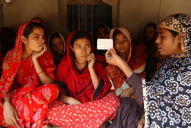 Photo of women learning about contraceptives.