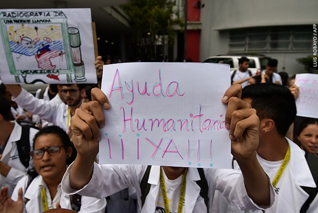 Workers of the University Hospital demand humanitarian aid during a protest against the government of President Nicolas Maduro.
