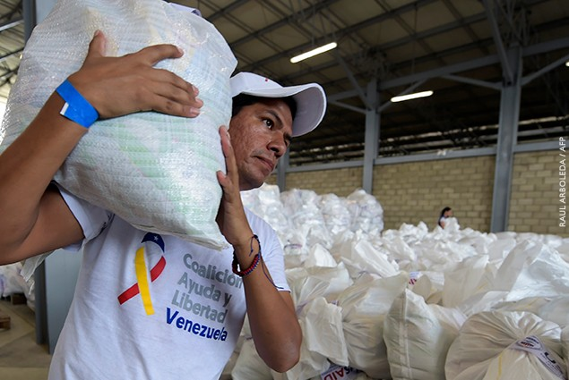 A volunteer carries a bag with US humanitarian aid goods in Cucuta, Colombia, on the border with Tachira, Venezuela.