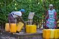 Image of two women filling water jugs in Ethiopia