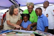 ission Director Jennifer Admas, Minister of Education Carmelita Namachulua and two Pupils at the Celebrations of Mother Language Day