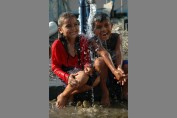 Children Play in Water Tap