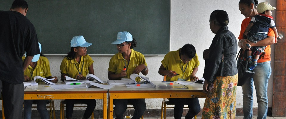 Voting center volunteers help voters obtain their ballots in Timor-Leste's 2012 elections.