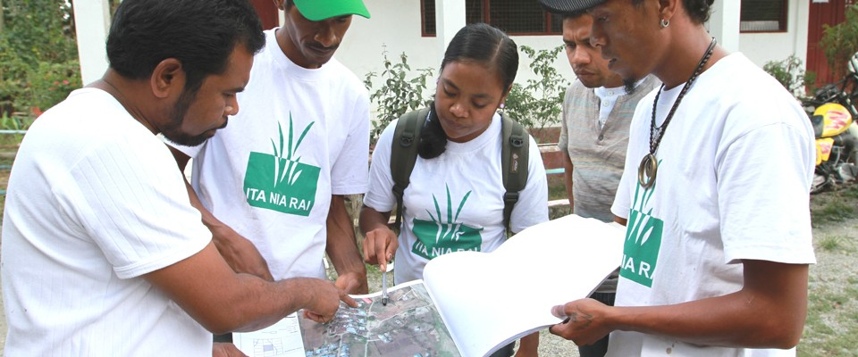 A property registration team from USAID's Our Land project helps a resident register his claim.