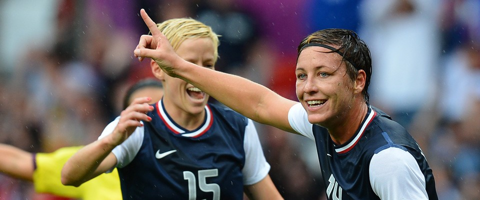 US' forward Abby Wambach (R) celebrates after scoring during the London 2012 Olympic Games. Credit: Andrew Yates / AFP