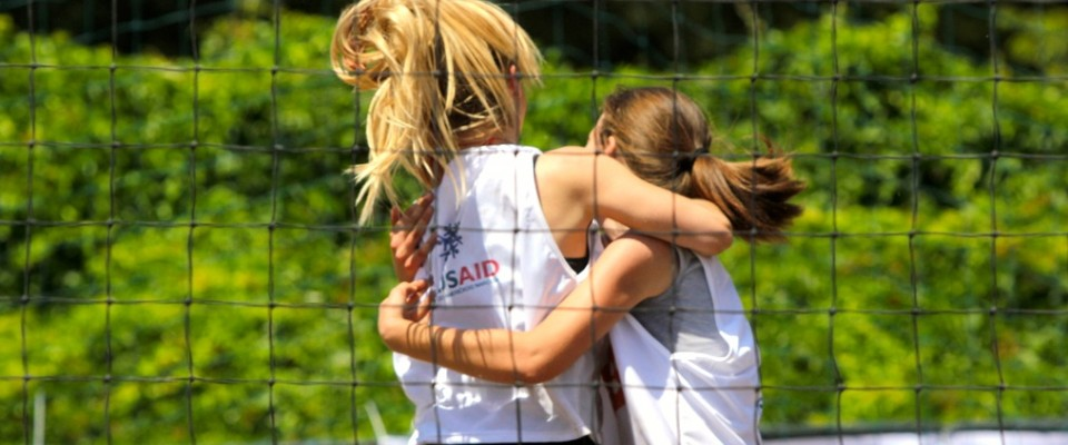 In Široki Brijeg, teen girls celebrate victory that earned them a place in volleyball finals in Sarajevo.