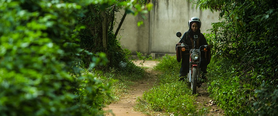Armed with two wheels, a tablet and lots of data, one woman takes on a deadly disease. Photo credit: Morgana Wingard