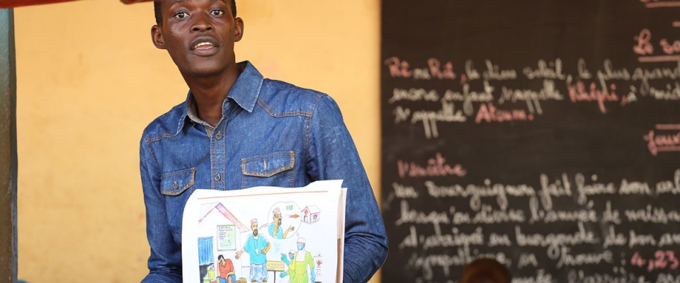 Mohamed Camara, a teacher at Le Salem School , in Conakry, Guinea, talks to students about Ebola safety and prevention.