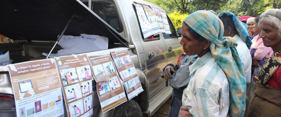 Sri Lankans check out a display of election instructions, part of an awareness campaign that came ahead of 2018 elections that saw record numbers of women elected to local offices. / IFES