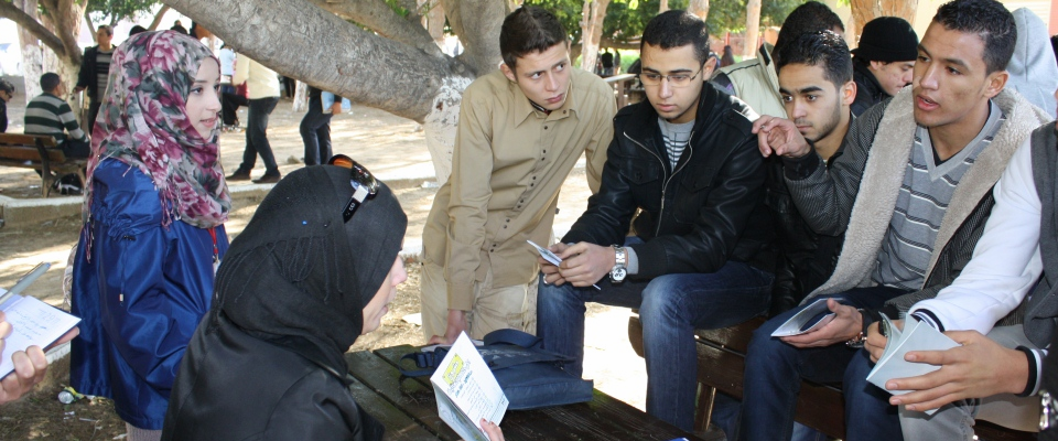 Members of a USAID-supported Libyan youth group train university students on Libya's transition to democracy.