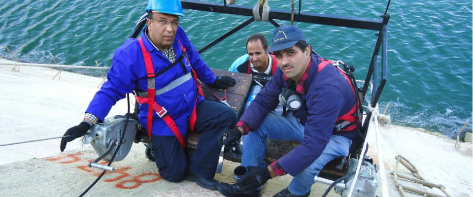 Technical staff inspect the face joints of a dam in Bekaa, Lebanon, through a USAID-funded program.