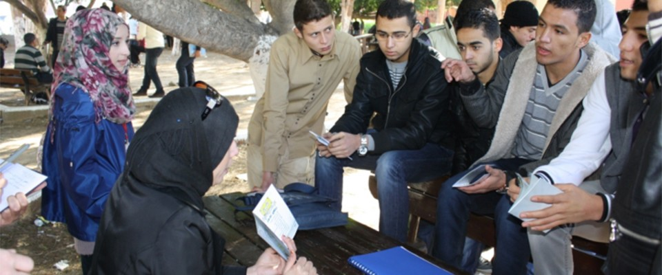 Members of the Libya youth organization H2O explain the transition to democracy to university students.