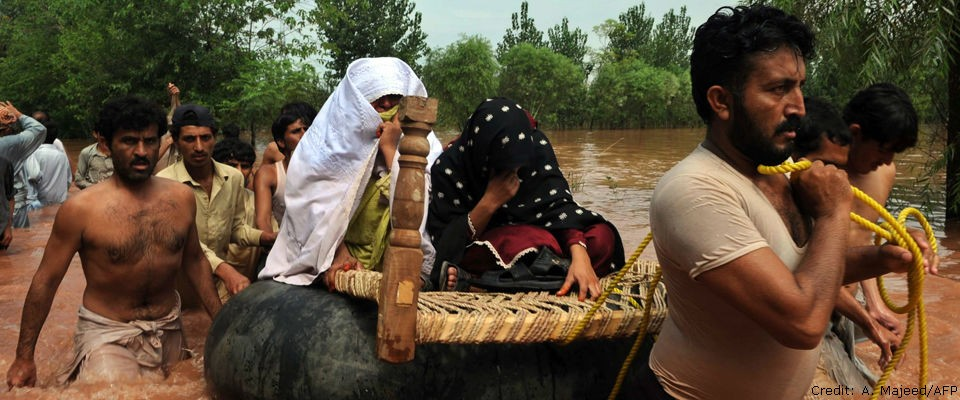 Residents evacuate to safety in a flood-hit area of Nowshera, Pakistan on July 30, 2010.