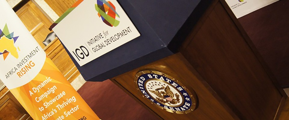 picture of a speakers podium with words Initiative for Global Development