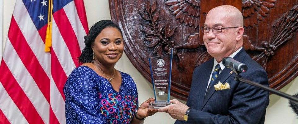 Ambassador Jackson presenting Mrs Cahrlotte Osei with the award