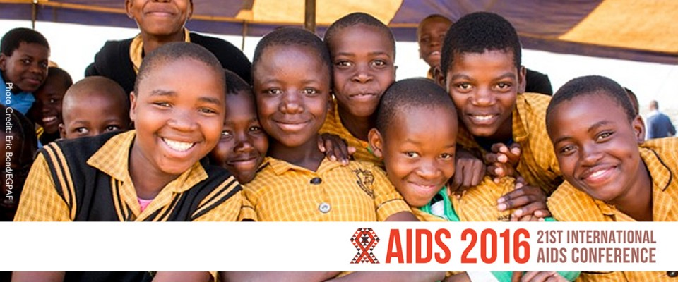 Young boys smile at the camera. AIDS 2016. 2ist Annual International AIDS Conference