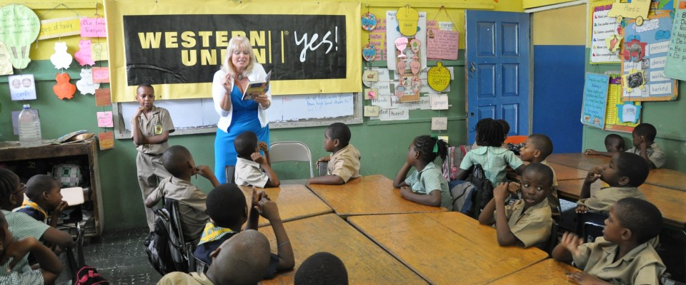 USAID/Jamaica Mission Director, Denise Herbol reading to students