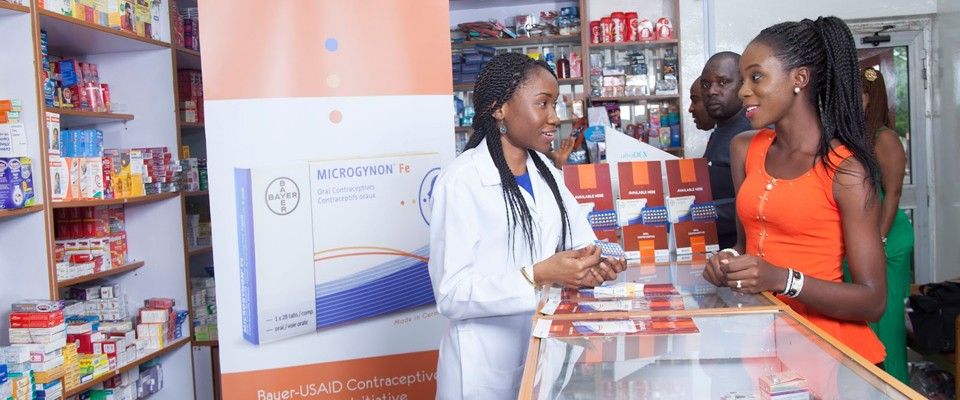 A pharmacist speaks to customers