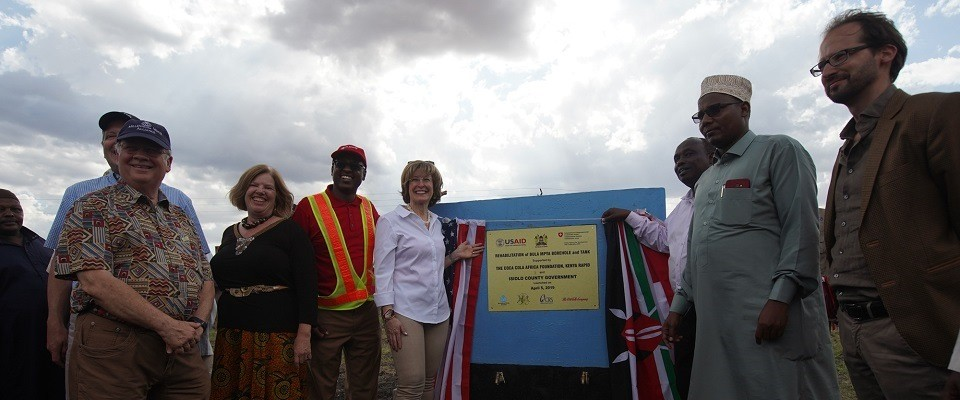 USAID Deputy Administrator Bonnie Glick (white top), the Deputy Governor of Isiolo County Dr. Abdi Issa (Near right flag), together with other senior county government officials and development partners from the Coca Cola Foundation and Kenya Rapid launched a borehole and tank in Bula Mpya Primary School- Isiolo County in April 2019. The project helps school children and community members at large to regularly access clean water.