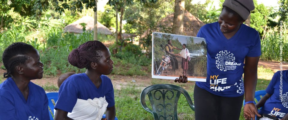 Photograph of peer champions from the DREAMS partnership visit adolescent girls and young women in their homes to hold small group or individual discussions on ways to prevent HIV and unplanned pregnancies. Photo Credit: USAID/Communication for Healthy Communities.