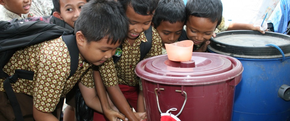 School children wash their hands
