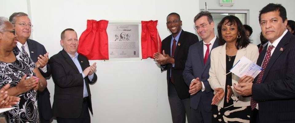 Chief Justice of Trinidad and Tobago the Honorable Ivor Archie and United States Embassy in Trinidad and Tobago Chargé d'Affaires John McIntyre unveil the plaque to officially open the new Children's Court